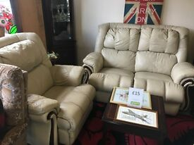 Cream leather sofa with 2 armchairs.