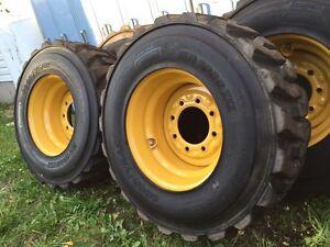 4 Skid steer tires 12x16.5 and wheels package