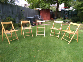5 wooden folding chairs