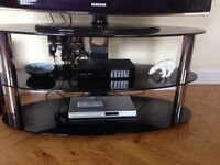 Black oval glass tv stand open to offers
