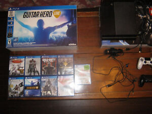 500GB PS4 with 2 controllers and 12 games + guitar hero live