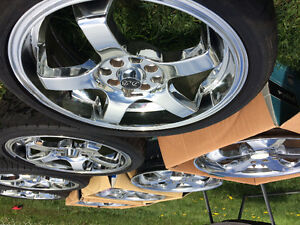 "2 sets of 17"" chrome rims with 4 new tires"