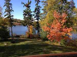REDUCED Waterfront Longbow Lake with rental suite, access to LOW