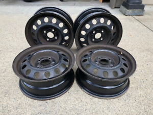 "14""x5.5 black wheel rims"