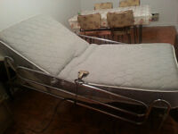 Adjustable hospital bed by Lumex