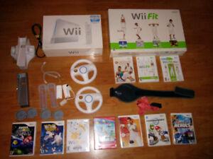 Console Wii, jeux, manettes, nunchuk et wi fit 10 jeux
