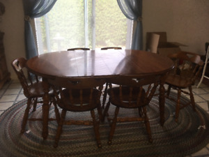 super clean solid wood table and 6 chairs