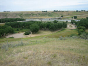 Stunning 4 acre view lot  1 block from other Taber residences!