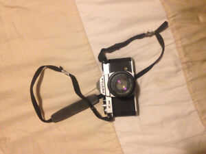 Pentax K1000 film camera with 3 interchangeable lenses