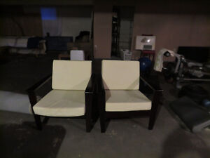 Two Wooden Office Chairs With White Cushions