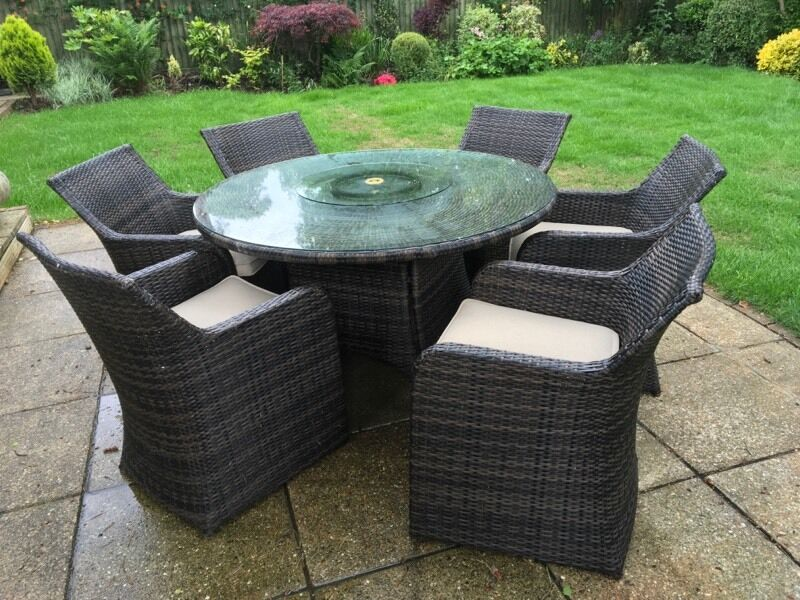 Rattan furniture setin Woking, SurreyGumtree - Brown rattan furniture set in very good condition 6 chairs and cushions (washable ) glass top and glass lazy Suzy (as in picture