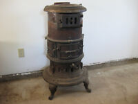 Round Wood Stove, about 4 ft tall