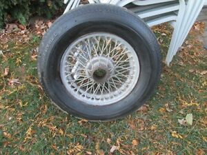 one MGB Wire Wheel with 4 knock off spinners.