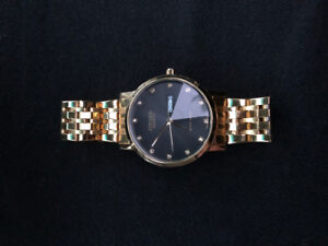 Citizen watch gold black face
