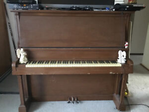 Older piano for sale $200.00  good sound