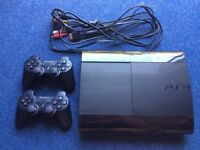 PS3 console and 2 controllers