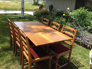 Oak trestle table and six ladder back chairs