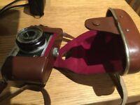 Four vintage Olympus cameras