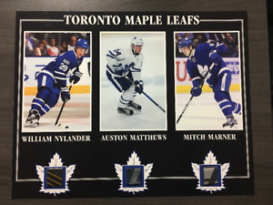 MATTHEWS, MARNER, NYLANDER PHOTO WITH PIECE OF GAME USED STICK
