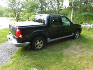 2003 Ford Explorer Sport Trac XLT Pickup Truck with Plow
