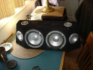 Speaker box with 8 inch woofers, mids and highs.