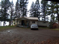 A Cozy Rancher w/ Worshop right on Bouchie Lake, 3.5 Treed Acres