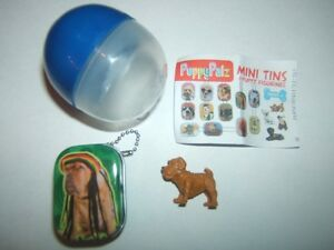 Tins with small dog figures