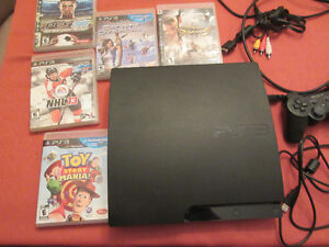 used Sony PlayStation 3 Slim 320 GB + games can deliver