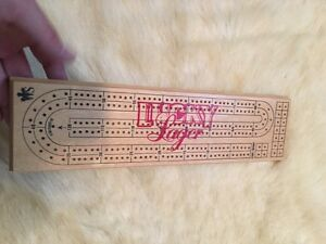 Lucky logger cribbage board