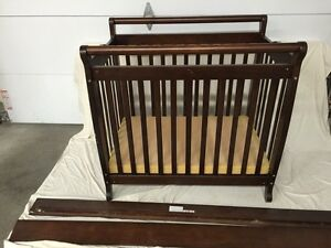Baby crib.  With ability to convert into toddler bed.