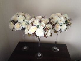 Six beautiful floral centrepieces in champagne flutes