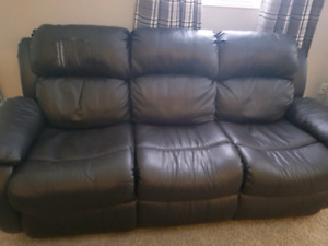 Reclining brown faux leather couch