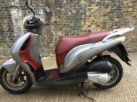 2007 Honda PS 125cc scooter 125 cc learner legal scooter. MOT. Has minor cracked plastic.