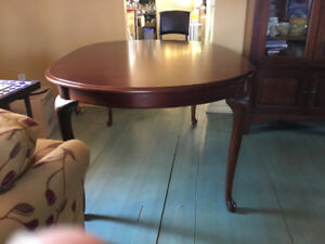 Oval cherry wood dining table with extensions and 6 chairs