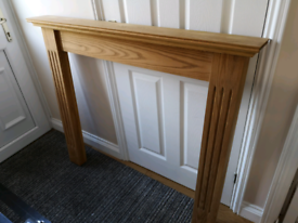 Solid wood fire surround.