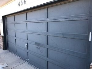 16 x 7 garage door wood with all hardware in good condition!!