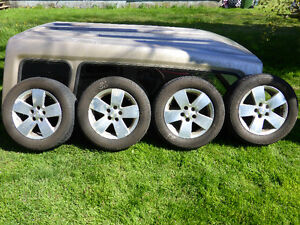 4- P215/60R16 Tires on GM Alloy Rims