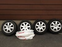VOLKSWAGEN  RIMS WITH ALL SEASON TIRES