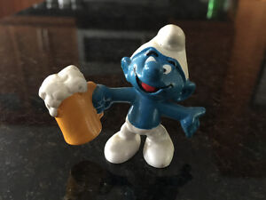 Smurf figurines. Chef angler beer postman hang glider