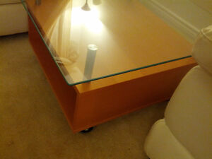 glass top coffee table and white loveseat