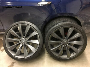 Tesla band new rims and tires