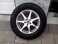 set of Bridgestone Blizzak winter tires with rims