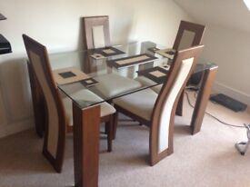 Julian Bowen Glass dining table set
