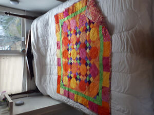 100% cotton hand pieced and sewen quilt.