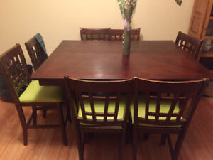 Large wood dining table with 8 chairs