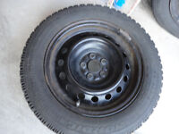 GOODYEAR NORDIC 4 WINTER TIRES WITH RIM $500.00 USED ONLY ONE SE
