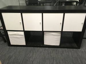 Two black cubby shelves/storage - with white doors