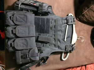 pair of adjustable tactical vests for Airsoft games.