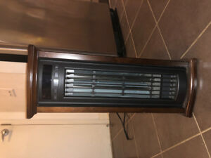 Brown electric heater, comes with remote control, barely used