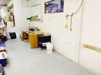Painting/ ceramics/ sculpture studio space with 13.5 ft H walls